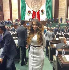 Tiktok suspends Mexican congresswoman's account after she shared a video of herself smoking a pipe to celebrate approval of bill that will pave the way for its legalization