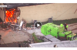 VIDEO: Garbage truck crashes into Michigan building, reveals illegal weed-growing operation